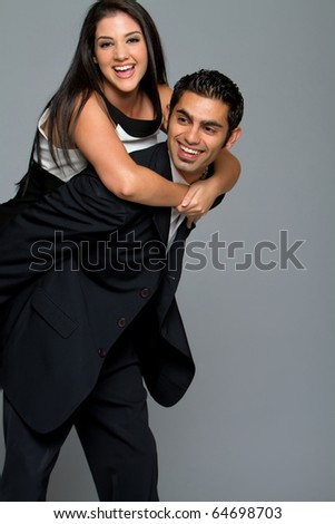 Happy young ethnic couple smiling - stock photo