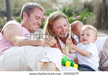 happy young family - bright family lifestyle portrait - stock photo