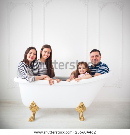 Happy young family dressed in sailors in bath. Summer travel, adventure and vacation concept - stock photo