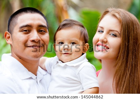 Happy young Family on Babies first Birthday - stock photo