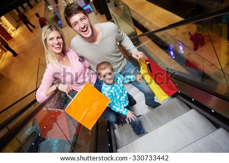 happy young family portrait in shopping mall - stock photo