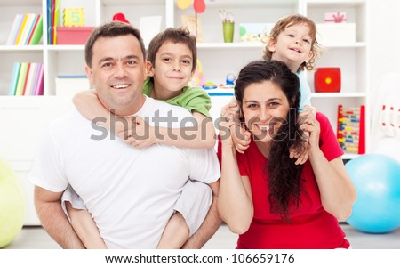 Happy young family portrait with two kids - stock photo