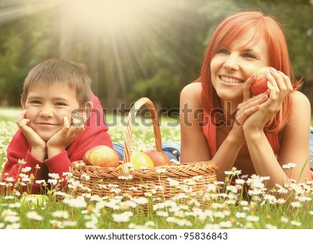 happy young family relaxing on a meadow - stock photo