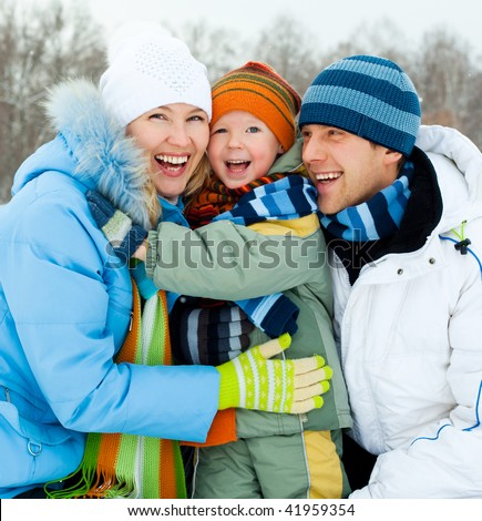 happy young family spending time outdoor in winter