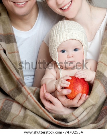 happy young family with kids in cozy plaid - stock photo