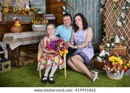 Happy young family with two pretty girls - stock photo