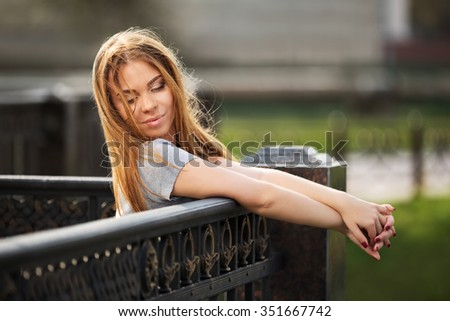 Happy young fashion woman on the city street - stock photo