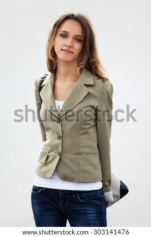 Happy young fashion woman with handbag - stock photo