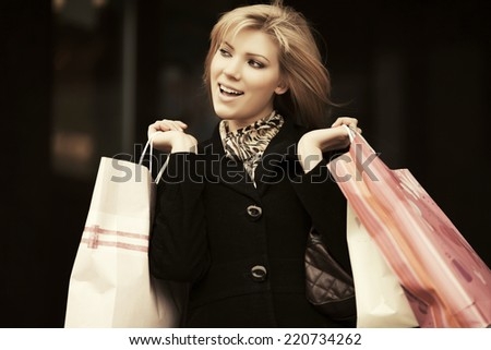 Happy young fashion woman with shopping bags  - stock photo