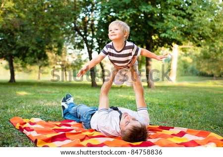 happy young father and son have fun and enjoy time - stock photo