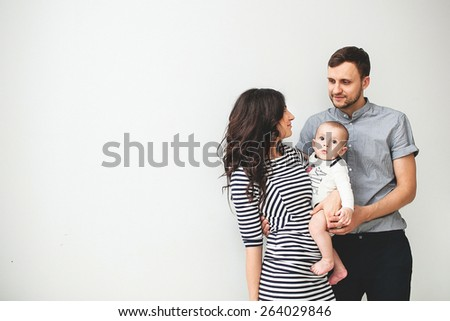 Happy young father, mother and cute baby boy over white background with copy space - stock photo