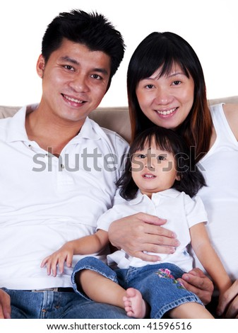 Happy young father, mother and daughter. - stock photo