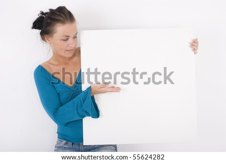 Happy young female holding big blank banner - stock photo