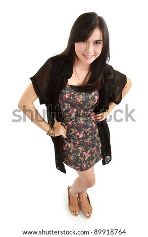Happy young female smiling on camera isolated against white - Top view - stock photo