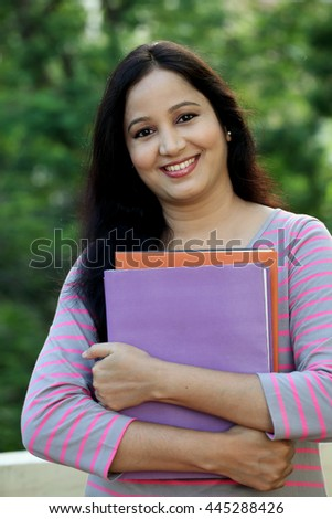Happy young female student at outdoors