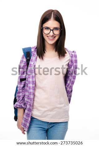 Happy young female student with backpack looking at camera over white background - stock photo