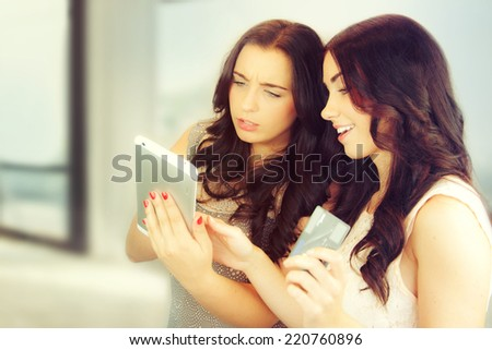 Happy young friends doing shopping on internet.  - stock photo