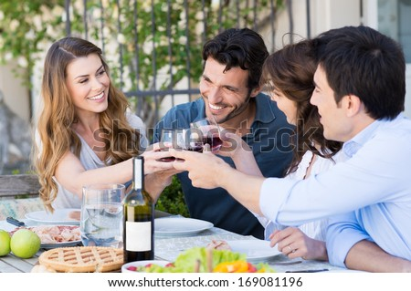 Happy Young Friends Eating Together Outdoor - stock photo