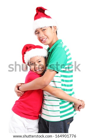 Happy young friends hugging at christmas. Isolated in white background. - stock photo
