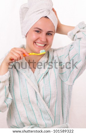 Happy young girl brushes her teeth - stock photo