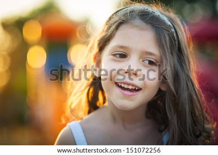Happy young girl close up portrait outdoors.  - stock photo