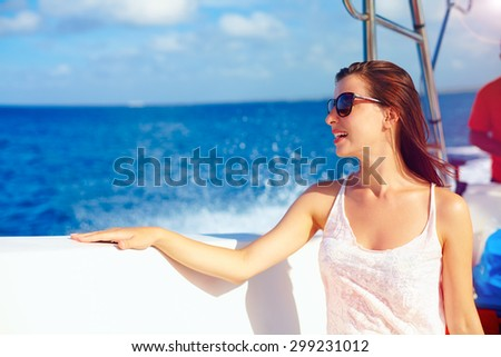 happy young girl enjoys summer vacation in ocean cruise on powerboat - stock photo