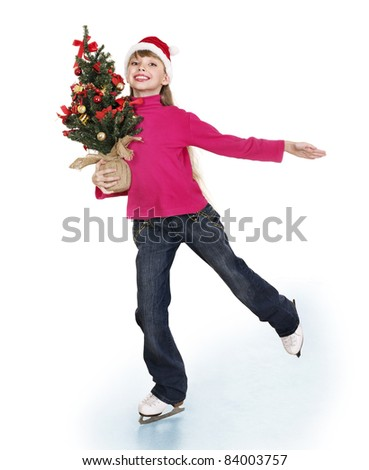 Happy young girl figure skating with christmas tree.. Isolated.