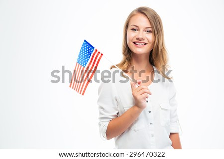 Happy young girl holding USA flag isolated on a white background - stock photo