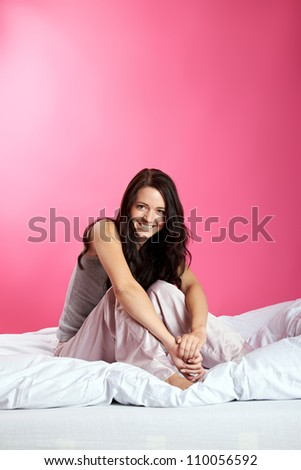 happy young girl in bed