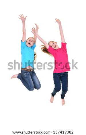 happy young girl in colored T-shirts jumping on a white background - stock photo