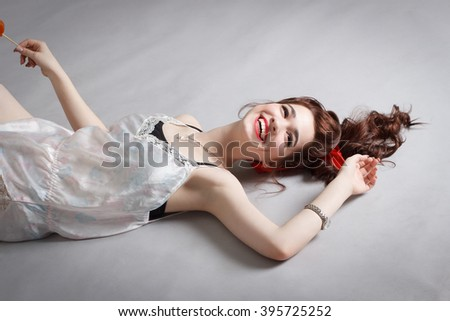 Happy young girl lying in pajamas . - stock photo