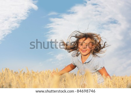 happy young girl on natural background - stock photo