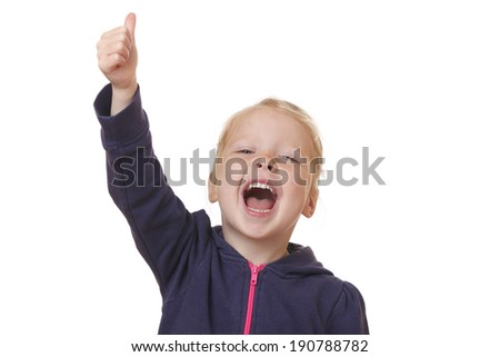 Happy young girl shows thumbs up on white background
