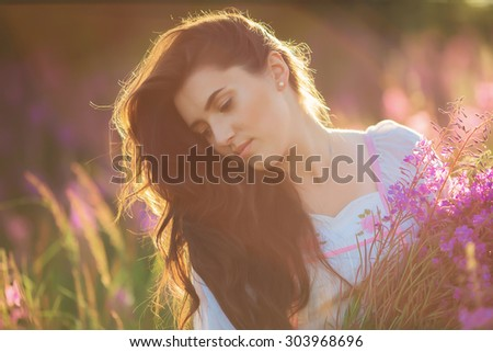 happy young girl smiling, holding hands in lavender. Soft focus, close-up
