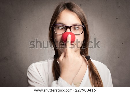 happy young girl with a clown nose - stock photo