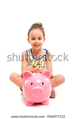 Happy young girl with a new piggy bank to start her savings - stock photo