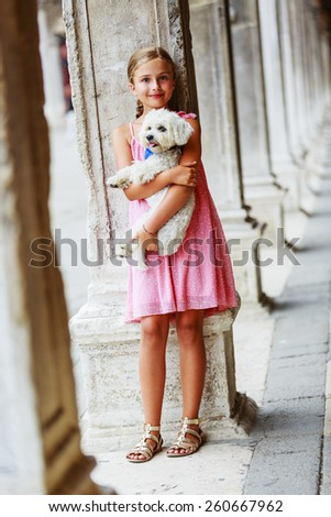 Happy Young Girl with her Dog in the City Venice, Italy. Youth Lifestyle Concept - stock photo
