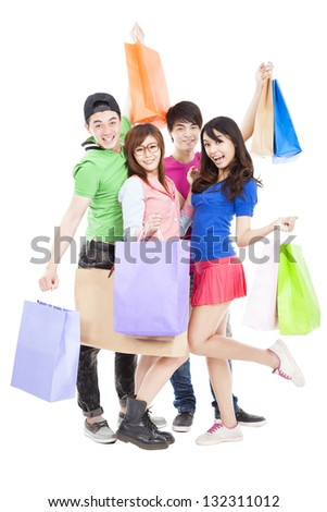 happy young group holding the shopping bags - stock photo