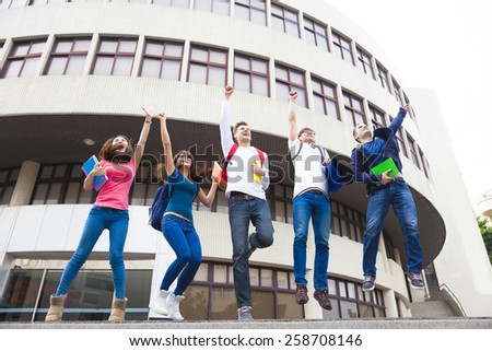 Happy young group of students jumping together  - stock photo