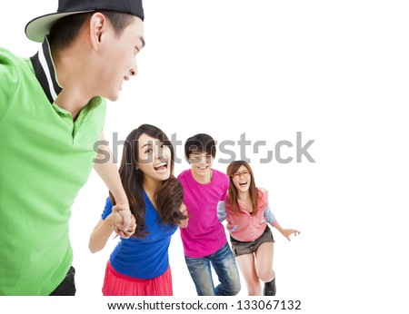 happy  young group with hand in hand and running for fun - stock photo