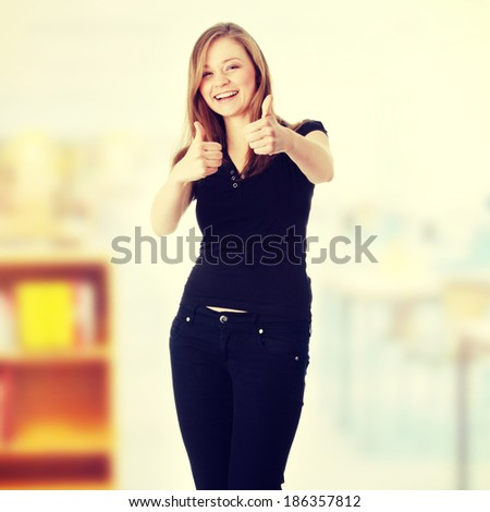 Happy young happy woman with thumbs up - stock photo