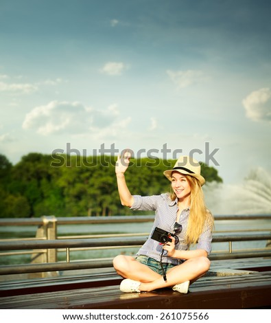 Happy Young Hipster Girl Waving Hello. Modern Youth Lifestyle Concept. Toned Photo. Copy Space. - stock photo