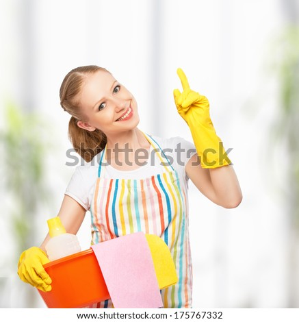 happy young housewife in glove at home kitchen - stock photo