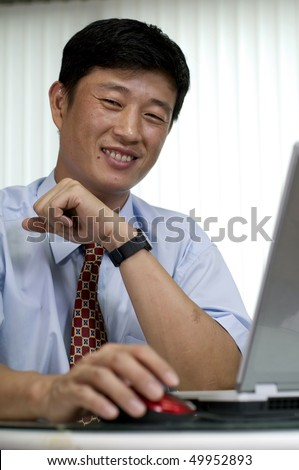 Happy young Korean manager - stock photo