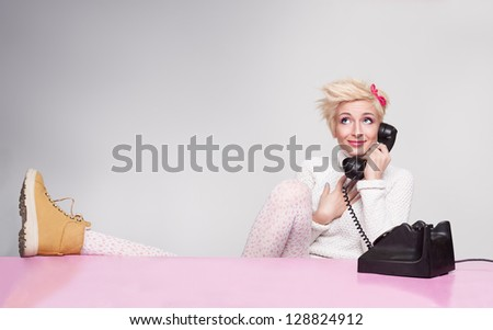 happy young lady having conversation with her boyfriend on the phone - stock photo