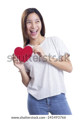 Happy young lady holding a red heart shape card for valentines day.Isolated in white background. - stock photo