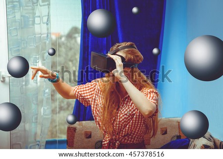 Happy young lady in virtual reality glasses with 3d globe around. VR helmet. third dimension. Virtual reality glasses.