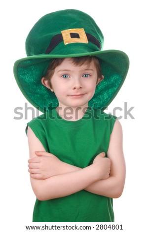 Happy young leprechaun boy wearing a humorous Saint Patrick's Day hat. - stock photo