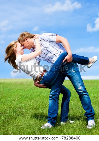 happy young loving couple having fun outdoor in summertime - stock photo