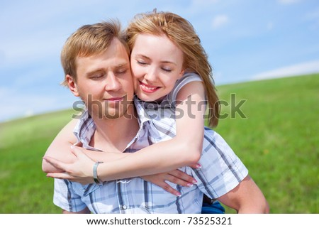 happy young loving couple outdoor in summertime - stock photo